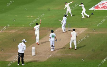 England's James Anderson, second left, celebrates his 600th test wicket after dismissing Pakistan's captain Azhar Ali during the fifth day of the third cricket Test match between England and Pakistan, at the Ageas Bowl in Southampton, England