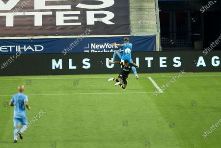 Luis Diaz (12) of Columbus Crew SC & Ronald Matarrita (22) of NYCFC fight for ball during MLS regular season game at Red Bull Arena. Game was played without fans because of COVID-19 pandemic precaution. NYCFC won 1 - 0. All supporting staff and players on the bench were wearing facial masks and kept social distances.