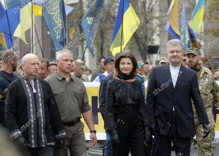 European Solidarity party headquarters chief Oleksandr Turchynov, Lieutenant General Mykhailo Zabrodskyi, Maryna Poroshenko and MP Petro Poroshenko (L to R) partake in the Independence March on the 29th Independence Day, Kyiv, capital of Ukraine.