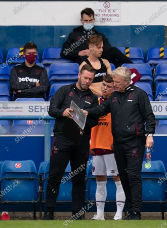 Stock Image of West Ham United Manager David Moyes and Assistant Kevin Nolan talk with Alfie Lewis of West Ham United