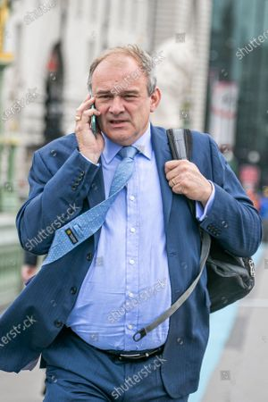 Stock Picture of Ed Davey, candidate bidding for the leadership of the Liberal Democrat party to replace Jo Swinson is seen on Westminster Bridge