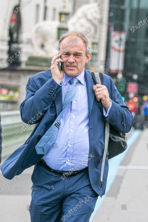 Stock Image of Ed Davey, candidate bidding for the leadership of the Liberal Democrat party to replace Jo Swinson is seen on Westminster Bridge