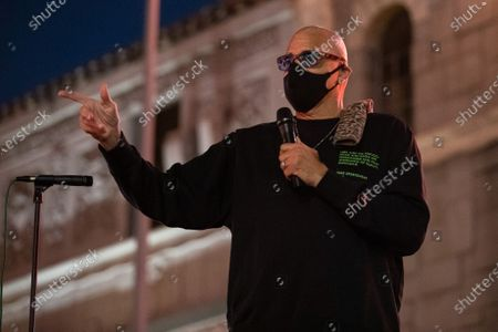 Stock Photo of Sinbad speaks at a one year violin candlelight vigil for Elijah McClain