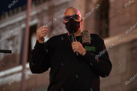 Stock Image of Sinbad speaks at a one year violin candlelight vigil for Elijah McClain