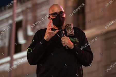 Stock Picture of Sinbad speaks at a one year violin candlelight vigil for Elijah McClain