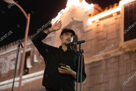Stock Picture of Yassir Lester speaks at a one year violin candlelight vigil for Elijah McClain