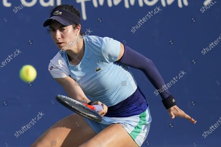Christina Mchale returns a shot to Ons Jabeur, of Tunisian, during the third round at the Western & Southern Open tennis tournament, in New York