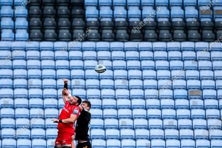James Phillips of Sale Sharks and Will Rowlands of Wasps challenge for a line out in front of an empty stand at the Ricoh Arena