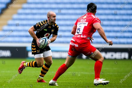 Stock Photo of Dan Robson of Wasps takes on James Phillips of Sale Sharks