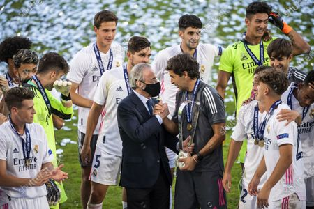 Real Madrid's team players celebrate with Real Madrid president Florentino Perez and Real Madrid's head coach Raul Gonzalez Blanco after the victory of the UEFA Youth League final soccer match between SL Benfica from Portugal and Real Madrid CF from Spain at the Colovray Sports Centre stadium in Nyon, Switzerland, 25 August 2020.
