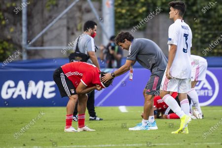 Real Madrid's head coach Raul Gonzalez Blanco, right, talks with Benfica's forward Tiago Araujo after the UEFA Youth League final soccer match between SL Benfica from Portugal and Real Madrid CF from Spain at the Colovray Sports Centre stadium in Nyon, Switzerland, 25 August 2020.