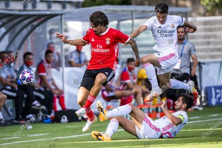 Benfica's forward Tiago Araujo, left, in action against Real Madrid's defender Victor Chust, center, and Real Madrid's defender Miguel Gutierrez, right, during the UEFA Youth League final soccer match between SL Benfica from Portugal and Real Madrid CF from Spain at the Colovray Sports Centre stadium in Nyon, Switzerland, 25 August 2020.