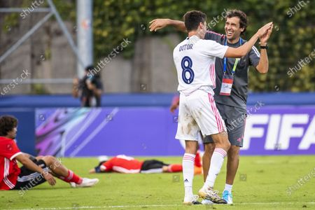 Real Madrid's head coach Raul Gonzalez Blanco, celebrates the victory with Real Madrid's midfielder Carlos Dotor after the UEFA Youth League final soccer match between SL Benfica from Portugal and Real Madrid CF from Spain at the Colovray Sports Centre stadium in Nyon, Switzerland, 25 August 2020.