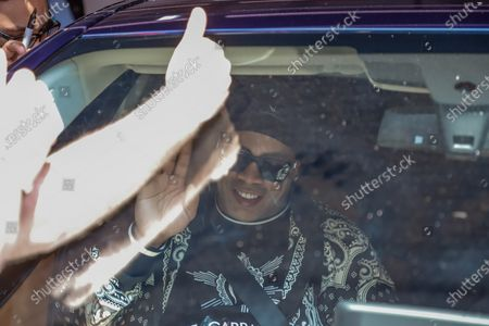 Ronaldinho Gaucho leaves the Hotel Palmaroga, heading to the airport, after being released following the judicial process he faced over the use of false documents, in Asuncion, Paraguay, 25 August 2020. Ronaldinho Gaucho and his brother Roberto left the luxurious hotel where they were serving home confinement to the Asuncion airport to take a flight to Rio de Janeiro, after almost half a year detained in Paraguay for using falsified documents.