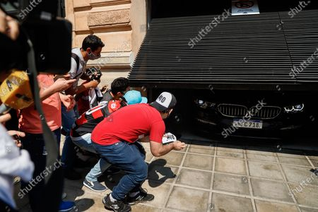 Fans await the departure of Ronaldinho Gaucho from the Hotel Palmaroga, heading to the airport, after being released following the judicial process he faced over the use of false documents, in Asuncion, Paraguay, 25 August 2020. Ronaldinho Gaucho and his brother Roberto left the luxurious hotel where they were serving home confinement to the Asuncion airport to take a flight to Rio de Janeiro, after almost half a year detained in Paraguay for using falsified documents.