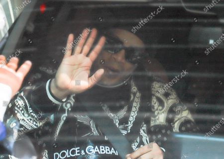 Former Brazilian soccer player Ronaldinho Gaucho waves as he leaves the Hotel Palmaroga, heading to the airport, after being released following the judicial process he faced over the use of false documents, in Asuncion, Paraguay, 25 August 2020.  Ronaldinho and his brother Roberto de Assis Moreira began their return travel to Rio de Janeiro after being arrested for some five months due the use of fake passaports at their entrance to Paraguay.