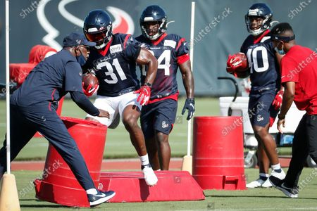 Houston Texans running back David Johnson (31) runs a drill during an NFL training camp football practice, in Houston