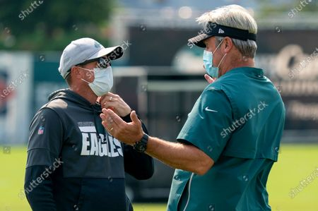 Philadelphia Eagles special teams coach Dave Fipp, left, listens to head coach Doug Pederson, right, during an NFL football practice, in Philadelphia