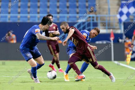 Al-Hilal's player Hyun Soo Jang (L) in action against Al-Faisaly's Youssef El Jebli (C) during the Saudi Professional League soccer match between Al-Hilal and Al-Faisaly, in Riyadh, Saudi Arabia, 25 August 2020.