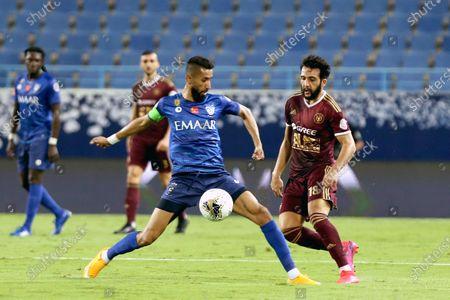 Al-Hilal's player Salman Al-Faraj (L) in action against Al-Faisaly's Mohammed Qassem (R) during the Saudi Professional League soccer match between Al-Hilal and Al-Faisaly, in Riyadh, Saudi Arabia, 25 August 2020.
