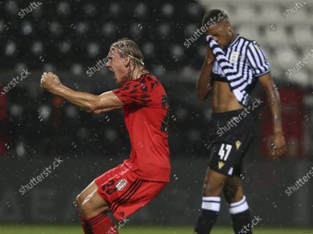 Besiktas' Domagoj Vida reacts after PAOK's Chuba Akpom, background, missed to score a penalty during the second qualifying round soccer match of Champions League between PAOK and Besiktas at Toumba stadium in the northern city of Thessaloniki, Greece