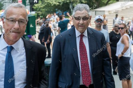 Former New York Assembly Speaker Sheldon Silver, right, arrives at federal court in New York. Silver has been sentenced to 6 1/2 years in prison. The sentencing by U.S. District Judge Valerie Caproni came after she insisted that the 76-year-old Democrat come to court rather than appear remotely. In a handwritten letter to the judge, Silver had asked that he be spared a prison term that would cause him to die in prison