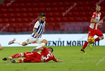 Fc Tirana player Agustin Torassa (1-C) in action with Red Star of Belgrade player Milos Degenek (2-C) during the UEFA Champions League second round of qualification match in Tirana, Albania, 25 August 2020.