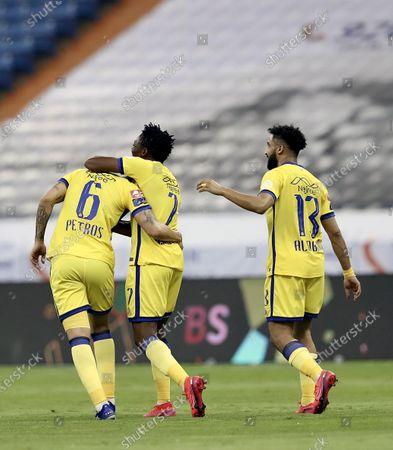 Al-Nassr's player Ahmed Musa (C) celebrates with teammates after scoring a goal during the Saudi Professional League soccer match between Al-Nassr and Al-Adalah, in Riyadh, Saudi Arabia, 25 August 2020.
