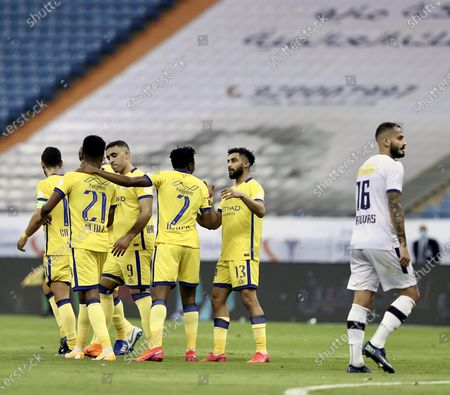 Stock Photo of Al-Nassr's player Ahmed Musa (C) celebrates with teammates after scoring a goal during the Saudi Professional League soccer match between Al-Nassr and Al-Adalah, in Riyadh, Saudi Arabia, 25 August 2020.