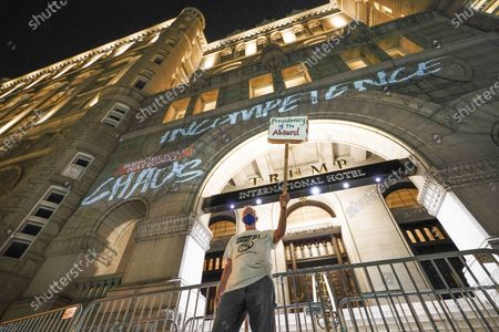 David Burrows protesting outside the Trump International Hotel during the second night of the Republican National Convention in Washington