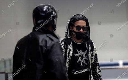 Ronaldinho Gaucho (R) arrives to Rio de Janeiro, Brazil, 25 August 2020. Former Brazilian soccer player Ronaldinho Gaúcho and his brother and businessman, Roberto de Assis, landed in Rio de Janeiro on 25 August after having been detained in Paraguay for almost six months for using false documents. Both arrived in Brazil accompanied by the lawyer Sergio Queiroz on a private charter flight that took off from Asunción a few hours after they reached an agreement with the Paraguayan Justice to put an end to the process they were facing and the National Defense Council (Codena) from Paraguay will authorize the flight.