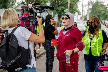 Activist Linda Sarsour is interviewed during the Good Trouble Tuesday march for Breonna Taylor, in Louisville, Ky
