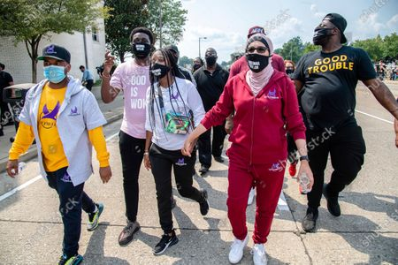 Activists Tamika D. Mallory, center, and Linda Sarsour participate in the Good Trouble Tuesday march for Breonna Taylor, in Louisville, Ky
