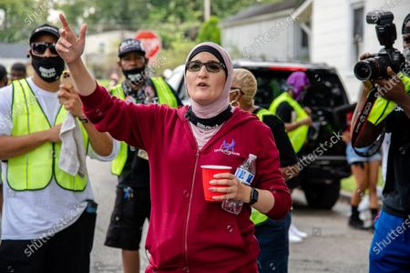 Activist Linda Sarsour, center, participates in the Good Trouble Tuesday march for Breonna Taylor, in Louisville, Ky