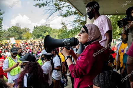 Linda Sarsour speaks during the Good Trouble Tuesday march for Breonna Taylor, in Louisville, Ky
