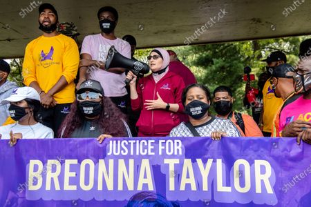 Linda Sarsour, center, speaks during the Good Trouble Tuesday march for Breonna Taylor, in Louisville, Ky