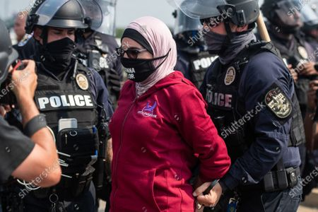 """LOUISVILLE, KY- AUGUST 25:  Linda Sarsour of Until Freedom is arrested near the University of Louisville on the final day of BreonnaCon, the """"Day of Action on August 25, 2020 in Louisville, Kentucky."""