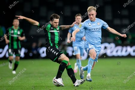 Stock Picture of Western United defender Josh Risdon (19) turns Melbourne City midfielder Nathaniel Atkinson (13)