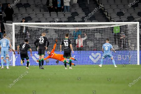 Melbourne City forward Jamie Maclaren (9) scores a penalty past Western United goalkeeper Filip Kurto (1)
