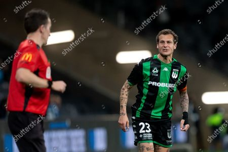 Western United midfielder Alessandro Diamanti (23) yells at the assistant referee