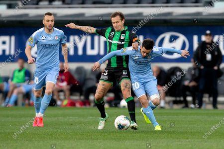 Stock Photo of Western United midfielder Alessandro Diamanti (23) and Melbourne City midfielder Adrian Luna (20) battle for the ball