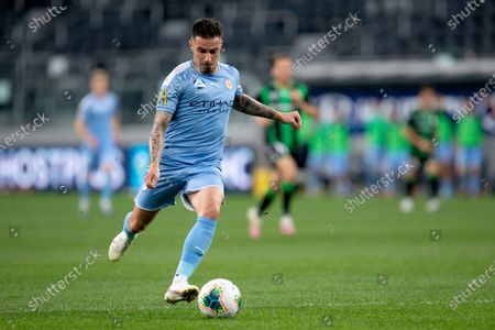 Melbourne City forward Jamie Maclaren (9) shoots at goal