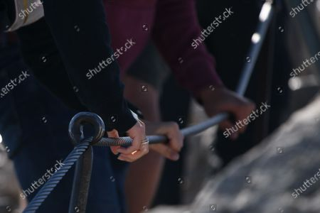 Tourists hold on to a steel cable on their way to the Zugspitze summit near Garmisch-Partenkirchen, Germany, 26 August 2020. Germany's highest mountain, the Zugspitze (2962m), was first climbed on 27 August 1820 by local mountain guide Johann Tauschl and Royal Bavarian surveyor Josef Naus. Today, the mountain sees some 600.000 visitors per year as the infrastructre around the summit and in the valley village of Grainau is frequently struggling with tourism overload.