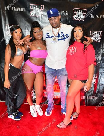 Stock Photo of Young Lyric, Erica Banks, Former Los Angeles Dodgers, MLB All Star and Founder of 1501 Certified Entertainment Carl Crawford and Guest attend the 1501 Backstage Pass Virtual Back To School Edition in Houston, Texas.25 Aug 2020