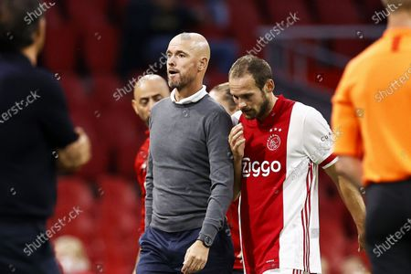 Ajax head coach Erik ten Hag (L) and Daley Blind (R) react during a pre-season friendly soccer match between Ajax Amsterdam and Hertha BSC at the Johan Cruijff Arena in Amsterdam, Netherlands, 25 August 2020 (issued on 26 August 2020). Blind, who was diagnosed with a heart condition in December 2019, 'feels good under the circumstances' after collapsing during the match, Dutch Eredivisie soccer club Ajax said on 26 August 2020.