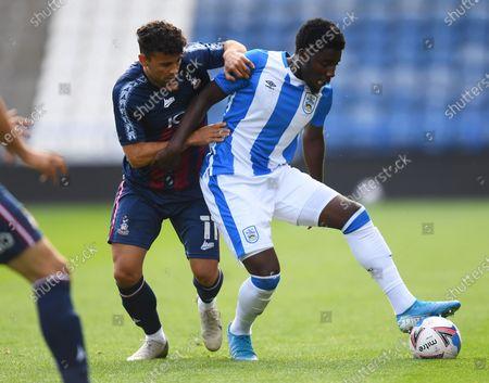 Zeli Ismail of Bradford City and Jaheim Headley of Huddersfield Town