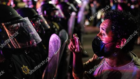 Man faces down riot police in Kenosha Wisconsin. Officers were attempting to disperse the crowd on Sheridan street. Tear gas, rubber bullets and flashbangs were deployed.