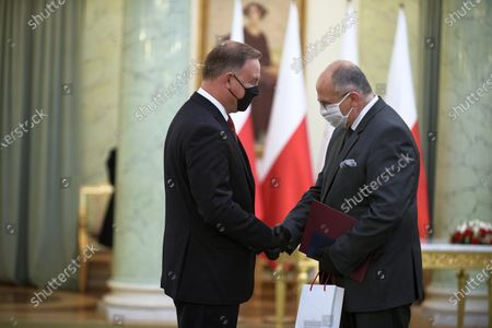 Polish President Andrzej Duda (L) appoints new foreign minister Zbigniew Rau (R) during the appointment ceremony at the Presidential Palace in Warsaw, Poland, 26 August 2020. Zbigniew Rau replaced Jacek Czaputowicz as foreign minister.
