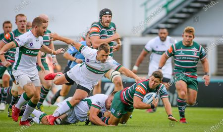 Ben Youngs gets tackled  during the Gallagher Premiership Rugby match between Leicester Tigers and London Irish at Welford Road Stadium, Leicester
