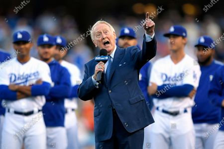 Los Angeles Dodgers broadcaster Vin Scully speaks during his induction into the team's Ring of Honor prior to a baseball game between the Dodgers and the San Francisco Giants, in Los Angeles. Scully has culled items from his personal collection of memorabilia for auction on Sept. 23